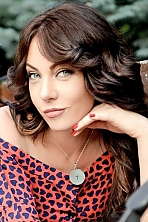 Ukrainian girl Sveta,39 years old with green eyes and light brown hair.