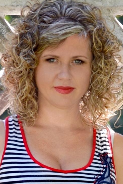 Ukrainian girl Nataliya,39 years old with green eyes and blonde hair.