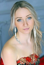 Ukrainian girl Viktoriya,26 years old with grey eyes and blonde hair.
