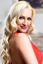 Ukrainian girl Alena,37 years old with brown eyes and blonde hair.