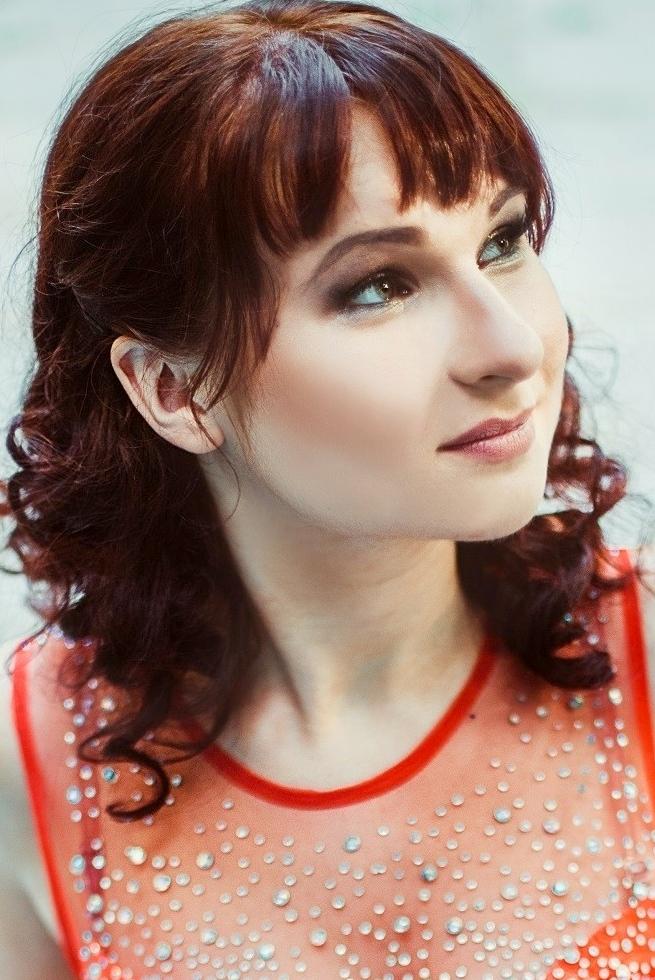 Ukrainian girl Marina,25 years old with green eyes and dark brown hair.