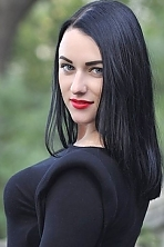 Ukrainian girl Maria ,27 years old with blue eyes and black hair.