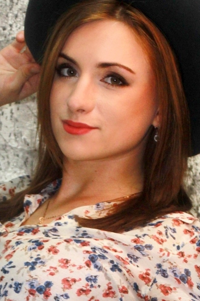Ukrainian girl Katerina,22 years old with green eyes and red hair.