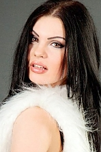 Ukrainian girl Olga,21 years old with brown eyes and black hair.