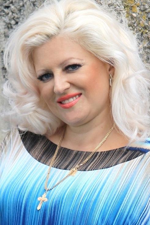 Ukrainian girl Svetlana,41 years old with blue eyes and blonde hair.