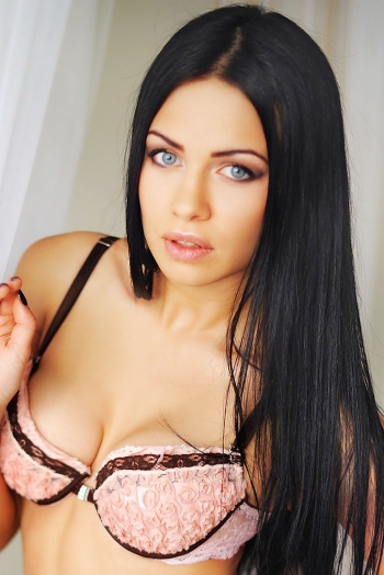 Ukrainian girl Tatiana,25 years old with blue eyes and black hair.