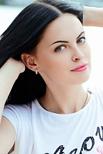 Ukrainian girl Diana,23 years old with blue eyes and black hair.