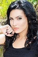 Ukrainian girl Anastasiia,25 years old with hazel eyes and black hair.