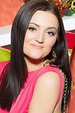 Ukrainian girl Natalia,24 years old with green eyes and dark brown hair.