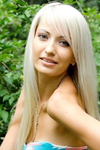 Ukrainian girl Nina,28 years old with green eyes and blonde hair.