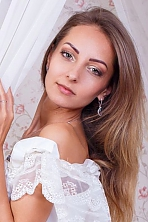 Ukrainian girl Ruslana,34 years old with green eyes and light brown hair.