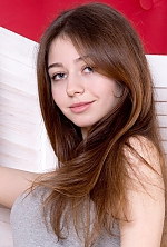 Ukrainian girl Alexandra,22 years old with grey eyes and light brown hair.