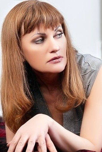 Ukrainian girl Lada,48 years old with blue eyes and red hair.