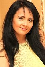 Ukrainian girl Nataliya,40 years old with green eyes and black hair.