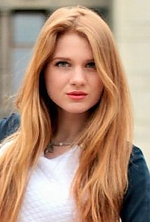 Ukrainian girl Elena,22 years old with green eyes and red hair.