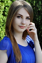 Ukrainian girl Anastasia,21 years old with blue eyes and light brown hair.