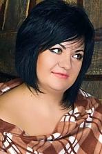 Ukrainian girl Olga,33 years old with green eyes and black hair.