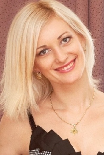 Ukrainian girl Tatyana,32 years old with blue eyes and blonde hair.