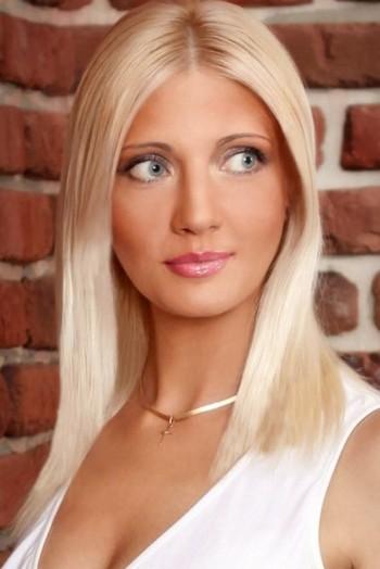 Ukrainian girl Irina,45 years old with grey eyes and blonde hair.