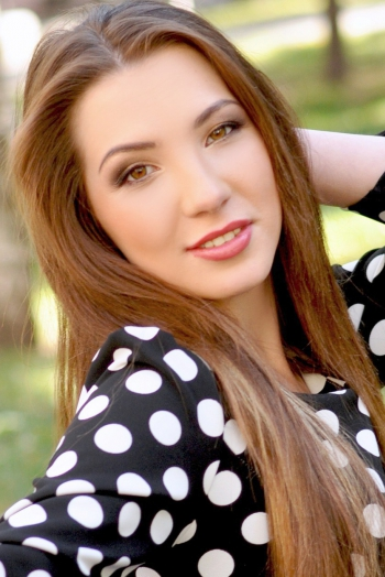 Ukrainian girl Anna,19 years old with brown eyes and dark brown hair.