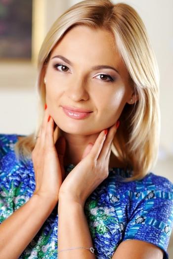 Ukrainian girl Tatiana,30 years old with brown eyes and blonde hair.