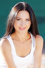 Ukrainian girl Daria,32 years old with green eyes and dark brown hair.