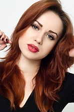 Ukrainian girl Inna ,25 years old with green eyes and red hair.