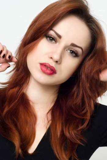 Ukrainian girl Inna ,26 years old with green eyes and red hair.