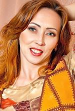 Ukrainian girl Inna,41 years old with green eyes and dark brown hair.