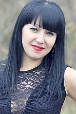 Ukrainian girl Anna,29 years old with brown eyes and black hair.