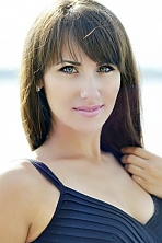 Ukrainian girl Olga,28 years old with green eyes and light brown hair.