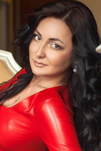 Ukrainian girl Anna,25 years old with hazel eyes and light brown hair.