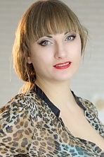 Ukrainian girl Nataliya,30 years old with blue eyes and blonde hair.