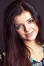 Ukrainian girl Victoria,20 years old with grey eyes and dark brown hair.