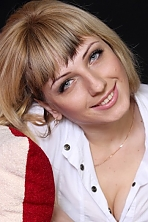 Ukrainian girl Viktoria,33 years old with blue eyes and light brown hair.