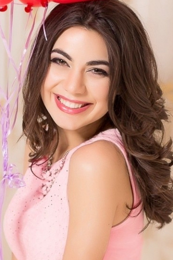 Ukrainian girl Anna,25 years old with brown eyes and dark brown hair.