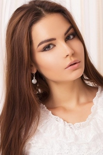 Ukrainian girl Sofia,21 years old with blue eyes and dark brown hair.