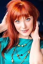 Ukrainian girl Alla,44 years old with blue eyes and red hair.