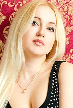 Ukrainian girl Galina,30 years old with grey eyes and blonde hair.