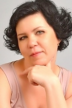 Ukrainian girl Camila,47 years old with grey eyes and black hair.