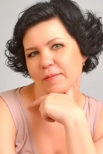 Ukrainian girl Camila,47 years old with grey eyes and black hair.