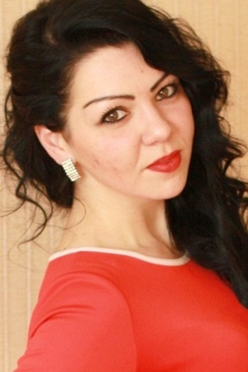 Ukrainian girl Alena,27 years old with black eyes and dark brown hair.