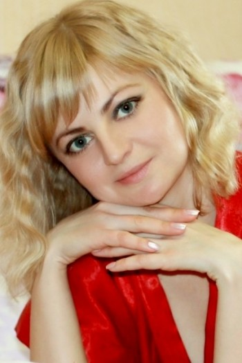 Ukrainian girl Tatiana,34 years old with blue eyes and blonde hair.