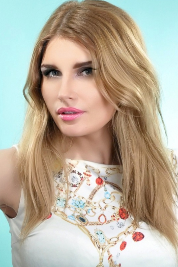 Ukrainian girl Ekateryna,27 years old with green eyes and blonde hair.