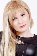 Ukrainian girl Anastasia,33 years old with grey eyes and blonde hair.
