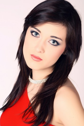 Ukrainian girl Uliya,24 years old with blue eyes and dark brown hair.