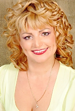 Ukrainian girl Tatiana,42 years old with brown eyes and blonde hair.