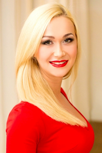 Ukrainian girl Natalia,28 years old with green eyes and blonde hair.