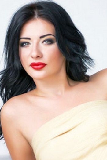 Ukrainian girl Marina,22 years old with green eyes and black hair.