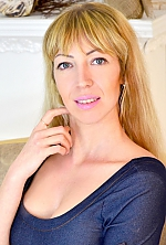 Ukrainian girl Elena,38 years old with green eyes and blonde hair.
